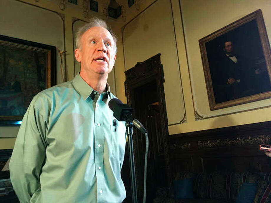 "In this Aug. 9, 2018, photo, Illinois Gov. Bruce Rauner speaks to the news media in his state Capitol office, in Springfield, Ill. On Friday, Aug. 24, 2018, Republican Rauner vetoed a Democratic measure designed to encourage immigrants to cooperate with police investigations, and drew criticism from Latino lawmakers for also rejecting legislation to create public ""safe zones"" that are off-limits to immigration enforcement and to prohibit landlords from reporting tenants they suspect are undocumented immigrants. Photo: AP Photo 