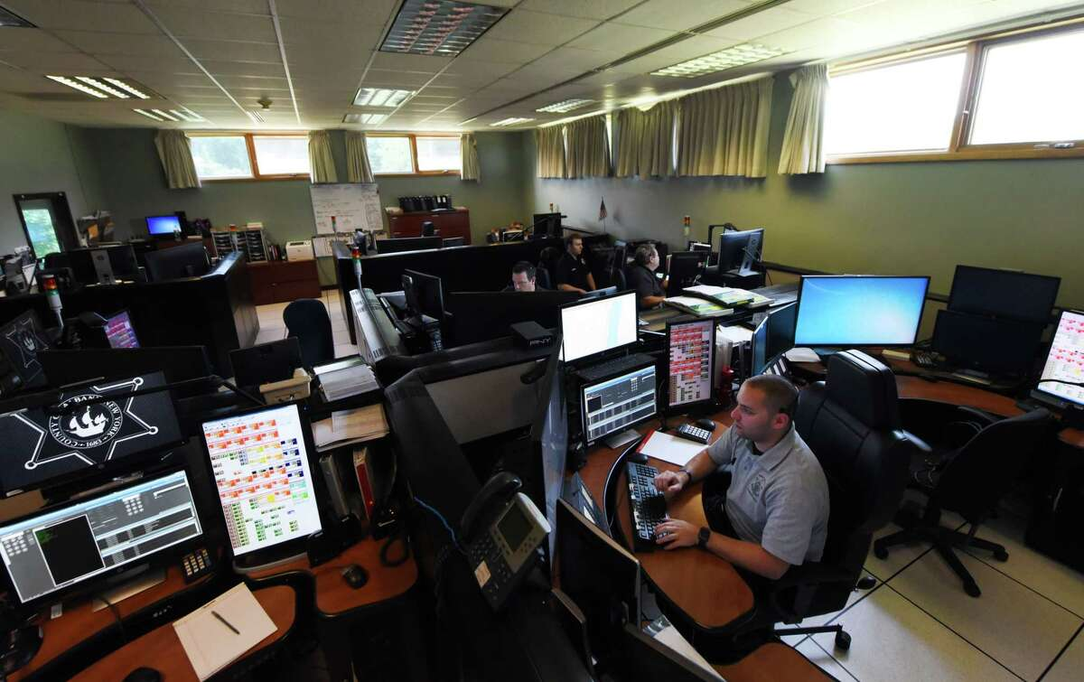 Albany County 911 dispatcher Dave Ainspan, right, waits for incoming calls at the county's dispatch center on Friday, Aug. 24, 2018, on New Salem Rd. in New Scotland, N.Y. (Will Waldron/Times Union)
