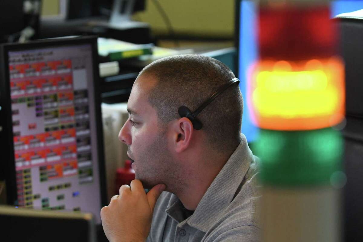 FILE - Albany County 911 dispatcher Dave Ainspan works a call at the county's dispatch center on Friday, Aug. 24, 2018, on New Salem Rd. in New Scotland, N.Y. (Will Waldron/Times Union)