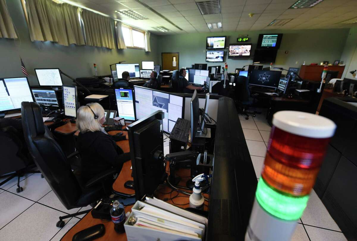 FILE - Albany County 911 dispatcher Jamie Bodo works a call at the county's dispatch center on Friday, Aug. 24, 2018, on New Salem Rd. in New Scotland, N.Y. (Will Waldron/Times Union)