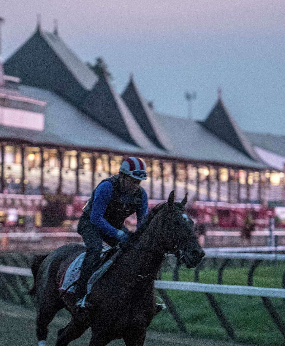 Travers Stakes entrant Wonder Gadot gallops on the main track as the sun rises at the historic Saratoga Race Course clubhouse Friday Aug. 24, 2018 in Saratoga Springs, N.Y. (Skip Dickstein/Times Union)