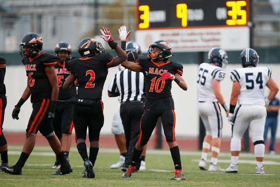 McClymonds' Kelvin Dunn Jr. (10) celebrates after making a tackle against visiting Marin Catholic. The Warriors took a 26-21 decision, dropping the Wildcats to 0-2 on the season. Photo: Santiago Mejia / The Chronicle