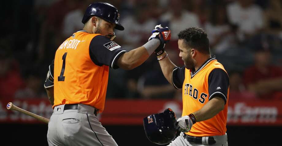 Houston Astros' Jose Altuve, right, celebrates his home run with Carlos Correa during the third inning of a baseball game against the Los Angeles Angels, Friday, Aug. 24, 2018, in Anaheim, Calif. (AP Photo/Jae C. Hong) Photo: Jae C. Hong/Associated Press
