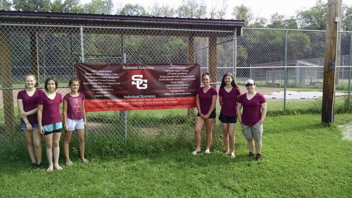 Five girl scouts from Troop 2104 hosted a ribbon-cutting ceremony at their  softball field in Glenville to celebrate their Silver Award achievement. The girls have spent the past 10 months renovating the Scotia-Glenville Softball League's clubhouse, concession stand and fields. From left, Grace Beauchamp, Alexa Lotano, Maddie Cook, Arrianna Stark, Hannah King and Ashton Wicks. (Photo by Tim Blydenburgh)