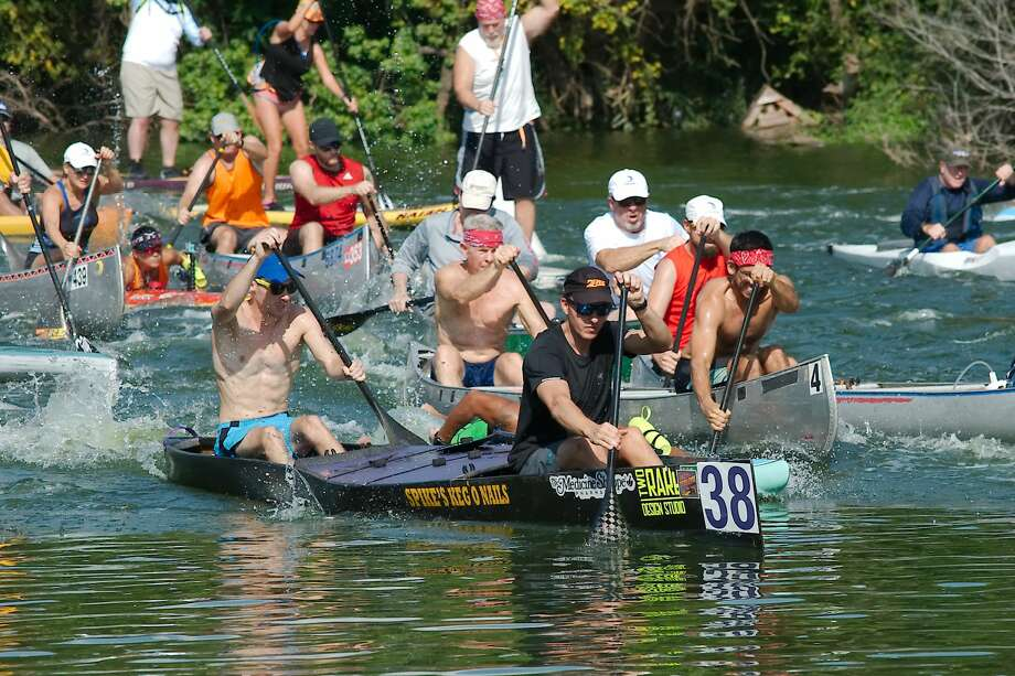 Paddlers maneuver canoes, kayaks and paddle boards at the start of the League City Clear Creek Paddle Race Saturday, Aug. 24. Photo: Kirk Sides/Houston Chronicle