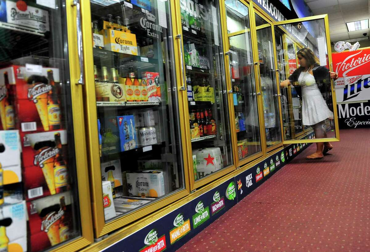 A customer shops in Bridgeport, Conn. liquor store on July 2, 2015.