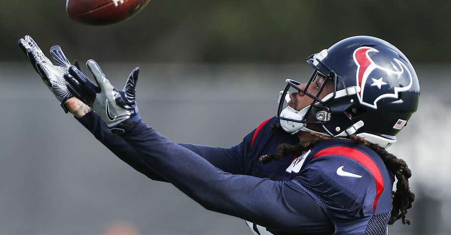 Houston Texans wide receiver Will Fuller reaches out to make a catch during training camp at the Methodist Training Center on Tuesday, Aug. 14, 2018, in Houston. Photo: Brett Coomer/Staff Photographer