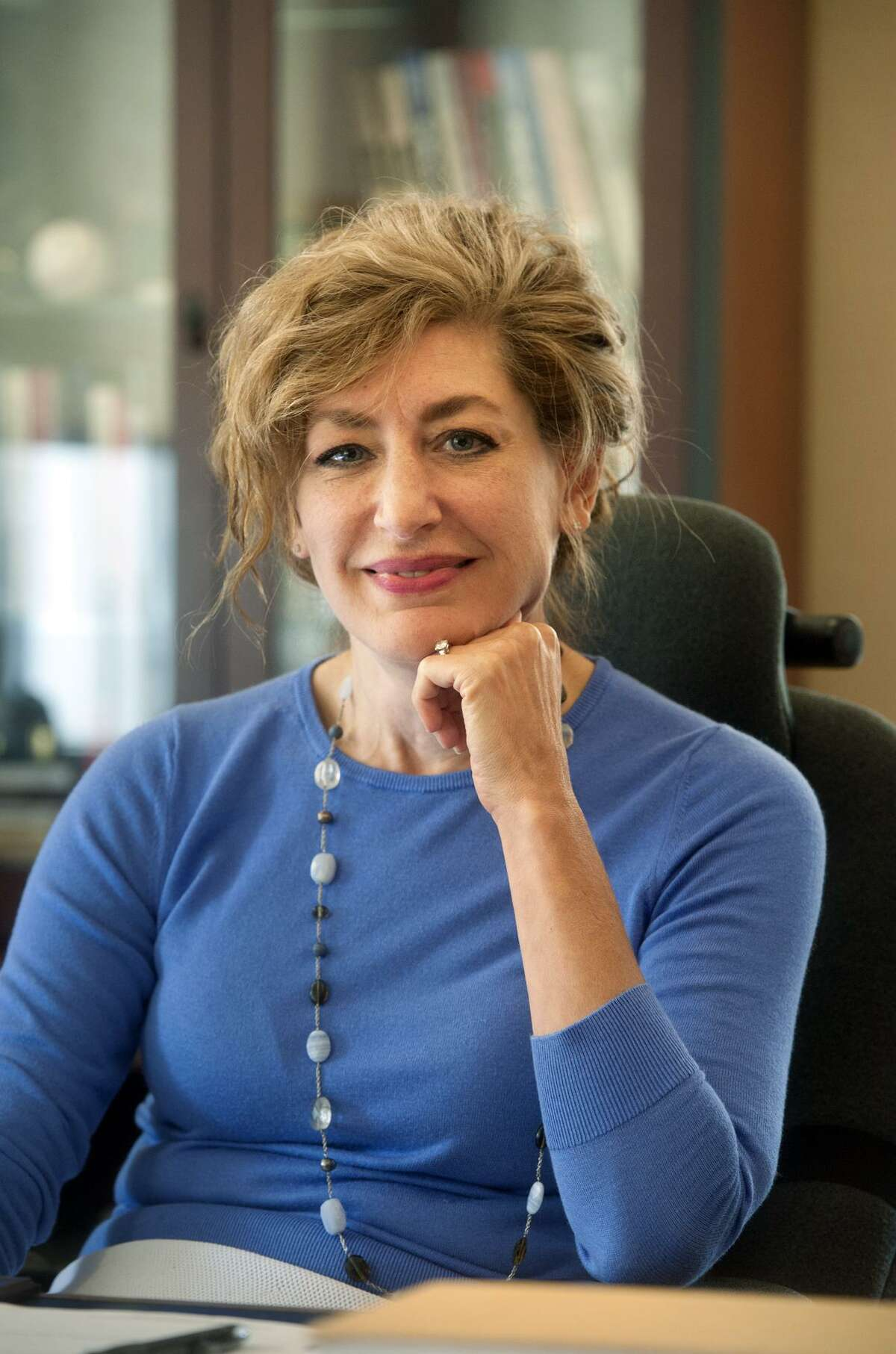 University of Connecticut President Susan Herbst poses in her office during an interview in Storrs on Monday. Herbst has announced that she will leave the university at the end of this academic year.