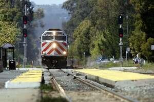 Event on 4/19/06 in Burlingame.  A CalTrain passenger train passes through Burlingame.