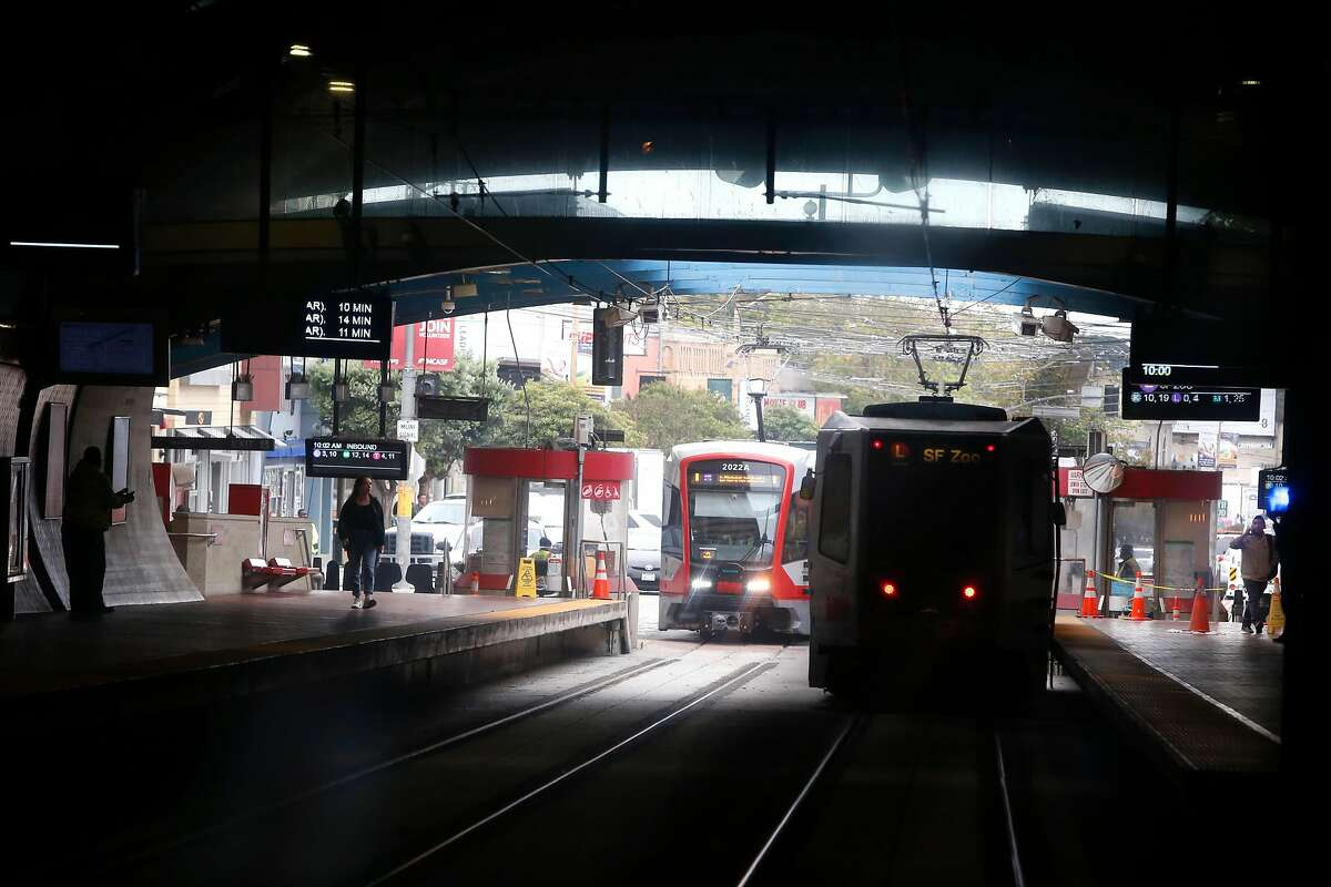 Muni Metro light rail trains roll through the West Portal station in San Francisco, Calif. on Saturday, Aug. 25, 2018. Muni is getting a new rider-information system for $89 million, while ancient, floppy-disk computers still route the trains.