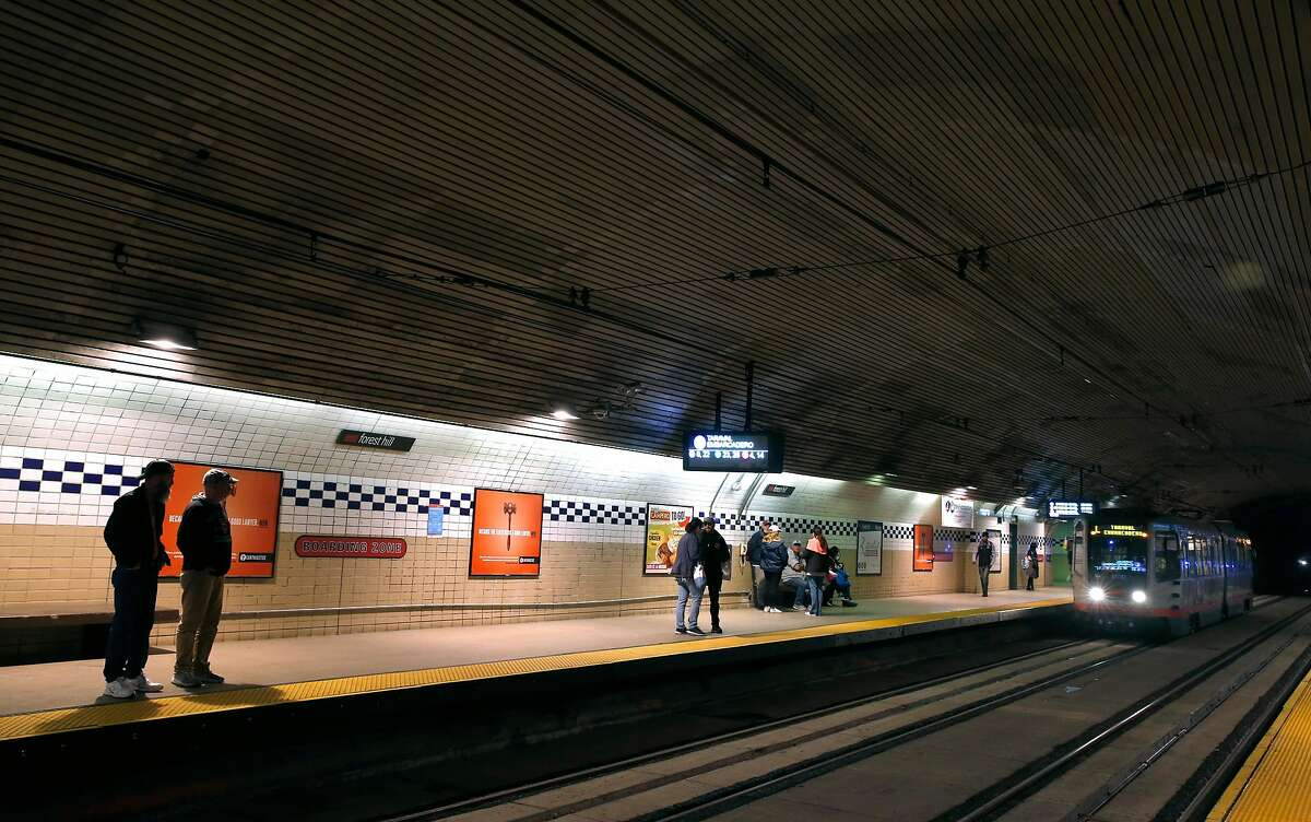Passengers wait for trains at the Forest Hill Station.
