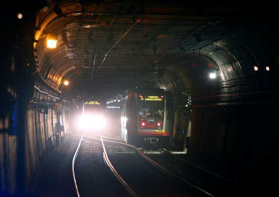 Muni trains travel through the Twin Peaks Tunnel last month. There are problems with the tunnel's automatic control system, the latest in a series on troubles there. Photo: Paul Chinn / The Chronicle