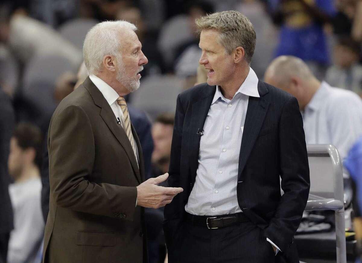 San Antonio Spurs head coach Gregg Popovich, left, and Golden State Warriors head coach Steve Kerr, right, visit before an NBA basketball game, Thursday, Nov. 2, 2017, in San Antonio. (AP Photo/Eric Gay)