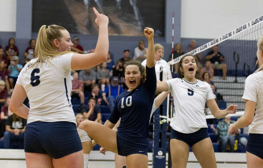 College Park players Annie Cooke (6), Jill Bohnet (10) and Abby Kremer (5) react after scoring a point during the second set of a non-district high school volleyball match at College Park High School on Saturday, Aug. 25, 2018, in The Woodlands Photo: Jason Fochtman/Staff Photographer