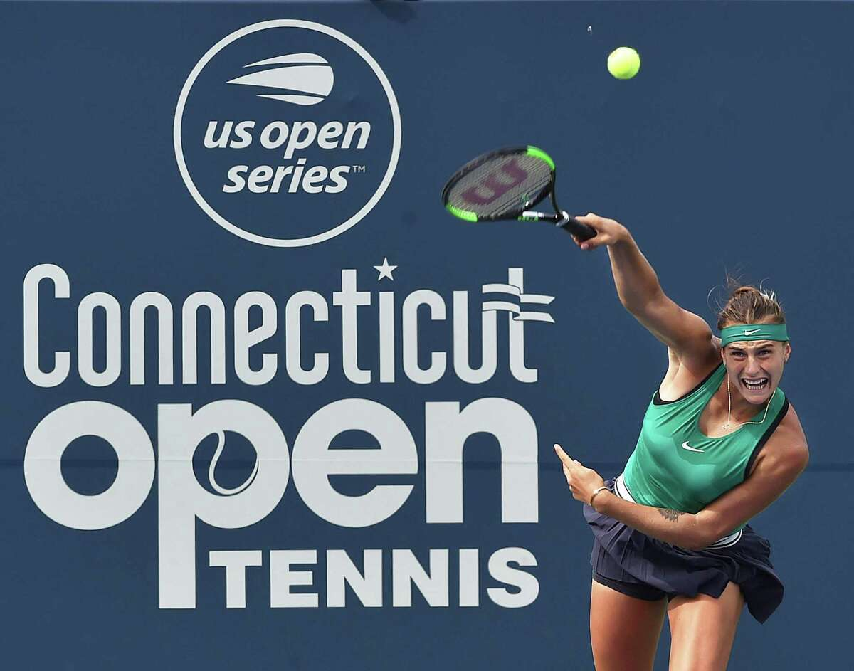 Aryna Sabalenka serves to Carla Suarez Navarro during the Connecticut Open final on Saturday. Sabalenka won to pick up her first WTA victory in a tournament that will go down as one of the more bizarre weeks in the event's history according to the Register's Chip Malafronte.