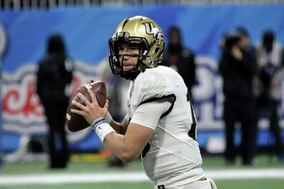 UCF quarterback McKenzie Milton drops back to pass during the Chick-fil-A Peach Bowl against Auburn. Milton was eighth in the Heisman voting last year after leading the Knights to an improbable 13-0 record and a victory over Alabama in the Peach Bowl. Photo: Icon Sportswire Via Getty Images / ©Icon Sportswire (A Division of XML Team Solutions) All Rights Reserved