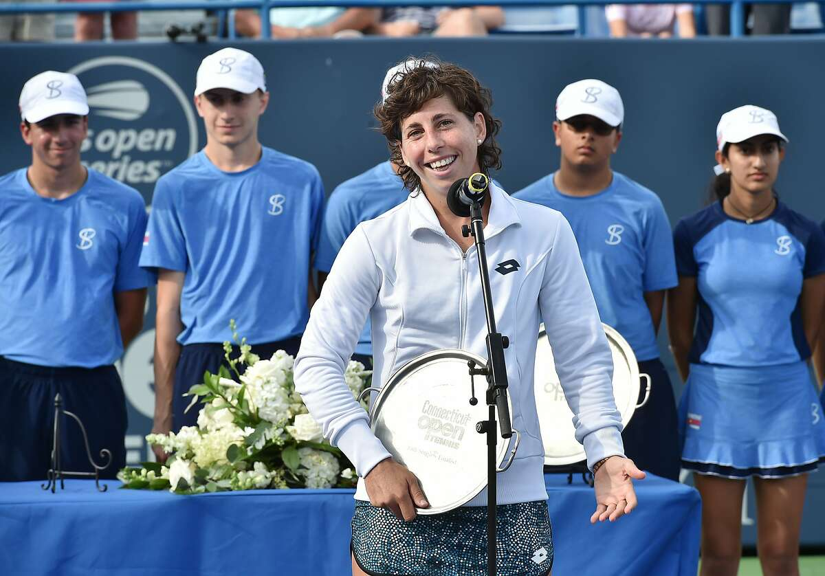 Spain's Carla Suarez Navarro congratulates Belarusian Aryna Sabalenka for winning the Connecticut Open championship on Stadium Court Saturday, August 25, 2018, at the at the Connecticut Tennis Center at Yale in New Haven. Sabalenka won, 6-1, 6-4.