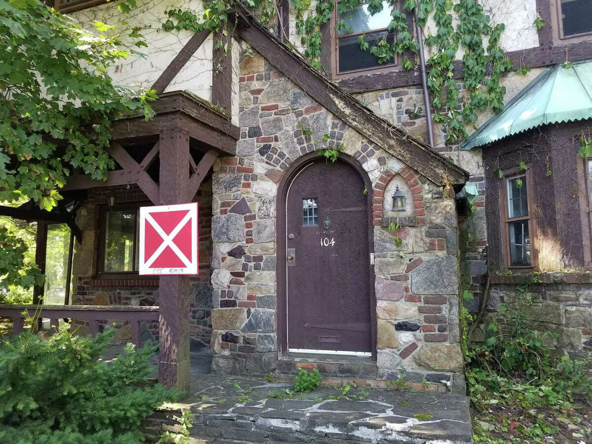 The Albany Fire Department has placed X placards on two of the six Tudor homes at 100-112 Holland Avenue, leading to fears that the vacant homes might soon be demolished. Picotte Cos., which owns the homes, says the fears are unfounded. (Chris Churchill / Times Union)