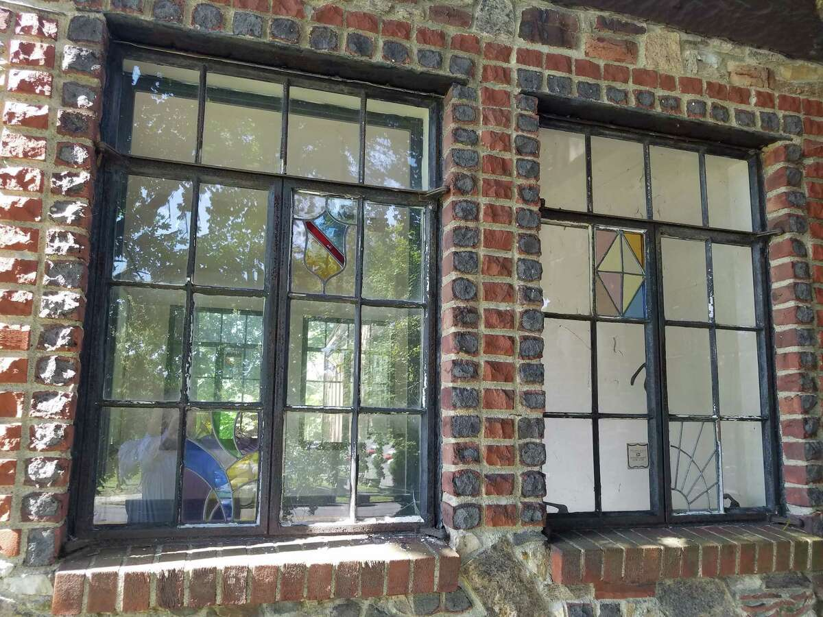 Window detail on one of the six historic Tudor-style homes on Holland Avenue near Albany Medical Center. Picotte Cos., which owns the houses, is hoping to find a person or organization willing to move them. (Chris Churchill / Times Union)