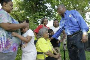 Lexus Dixon, left, her daughter, Porsha Henderson, 6, Joyce Follie, Lorita Malveaux, with her grandchildren Kamarion Henderson, 5, and Alexia Blackshear, 9, meet with Mayor Sylvester Turner outside the Kashmere Gardens home of Joyce Follie where reconstruction from Hurricane Harvey damage continues Saturday, Aug. 25, 2018, in Houston. The family is not able to live in the home until construction is finished.