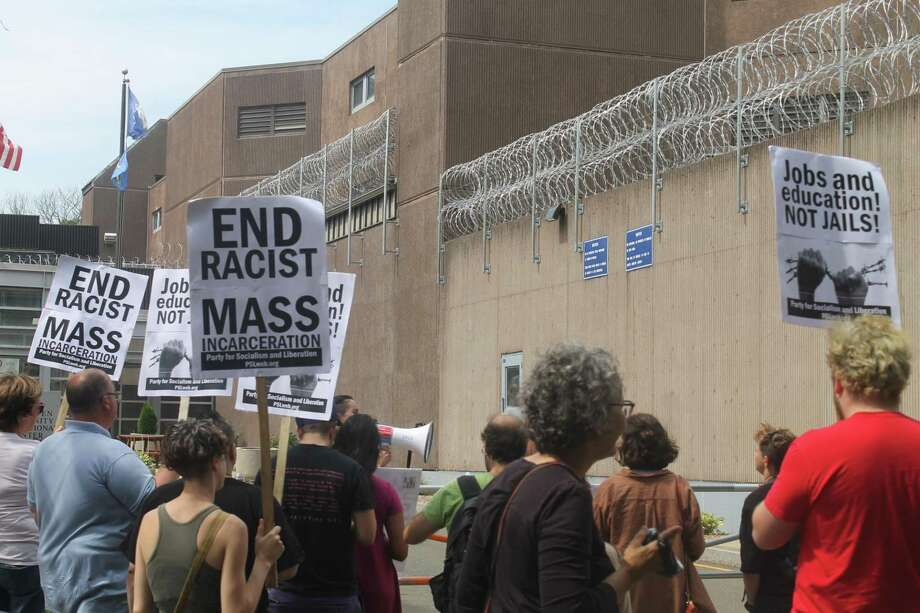About 70 people in New Haven rally for prison reform in conjunction with a nationwide prison strike in front of the Superior Court on Whalley Avenue before marching to the New Haven Correctional Center. Photo: Valerie Bannister