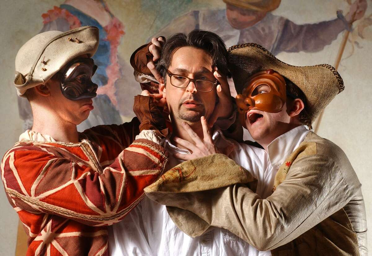 """Stephen Wadsworth has his hands full with two harlequins, each from a 2003 show. On the left is: Dan Donohue, performing in """"The Triumph of Love"""" at Long Wharf and Kevin Rich performing in """"Changes at Heart """"at the Yale University theater."""