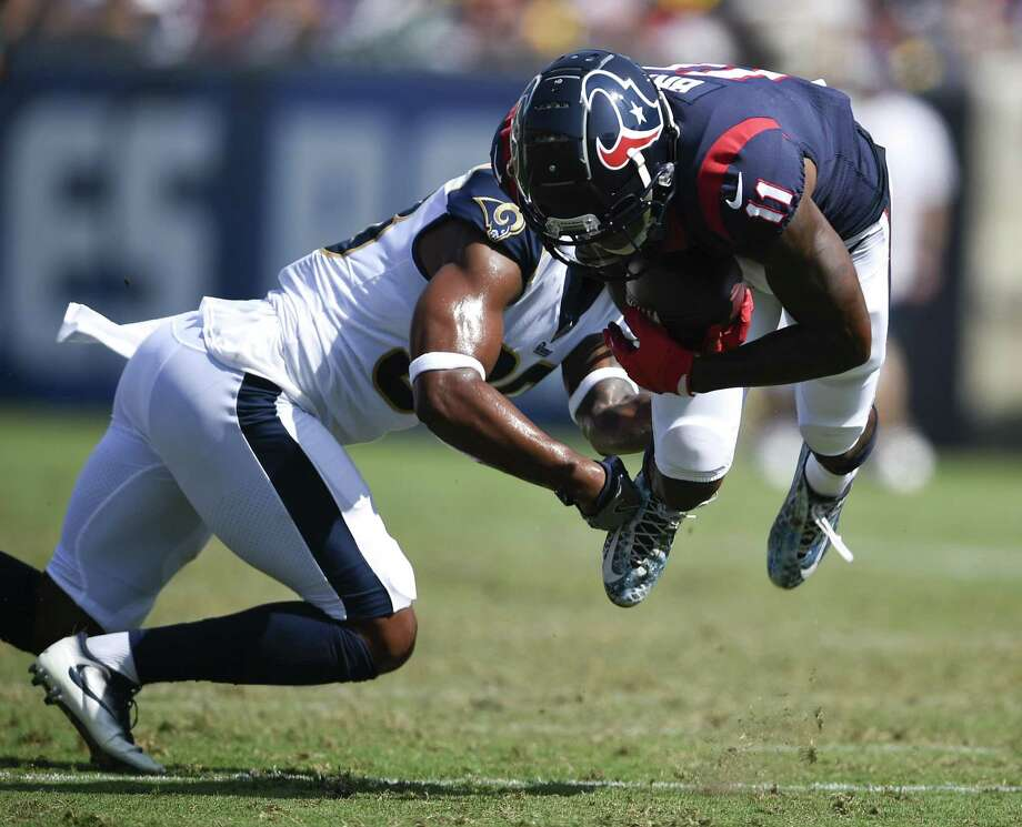 Houston Texans wide receiver Quan Bray is tackled by Los Angeles Rams defensive back Steven Parker during the second half of an NFL preseason football game Saturday in Los Angeles. Photo: Kelvin Kuo, FRE / Associated Press / Copyright 2018 The Associated Press. All rights reserved