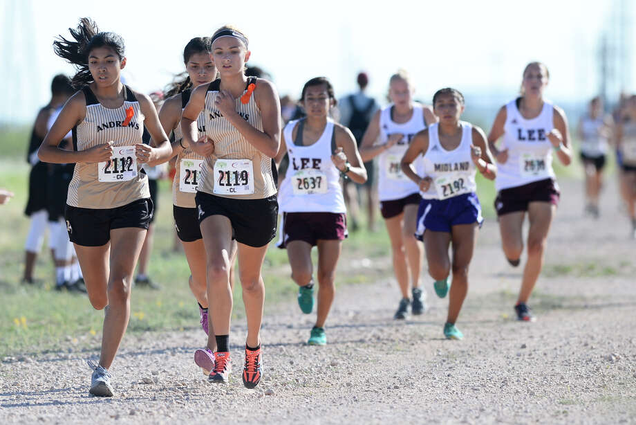 Andrews cross country runners from left Samantha Jasso, Elizabeth Garcia, and Jasmine Parker compete in the Girls Division 1 event of the Tall City Invitational Aug. 25, 2018, at the Rock The Desert grounds. Garcia (center) finished first in the event with a time of 21:27.75 and Jasso finished second in the event with a time of 21:33.13. James Durbin/Reporter-Telegram Photo: James Durbin / ? 2018 Midland Reporter-Telegram. All Rights Reserved.