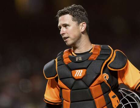 San Francisco Giants catcher Buster Posey talks to an umpire before the pitch against the Texas Rangers in the sixth inning of a baseball game in San Francisco, Friday, Aug 24, 2018. (AP Photo/John Hefti) Photo: John Hefti / Associated Press