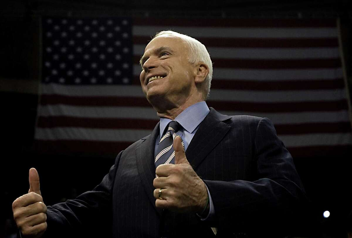 Republican presidential candidate Sen. John McCain flashes a thumbs up during a rally at The Crown Center in Fayetteville, N.C., Tuesday, Oct. 28, 2008. (Corey Lowenstein/Raleigh News & Observer/TNS)