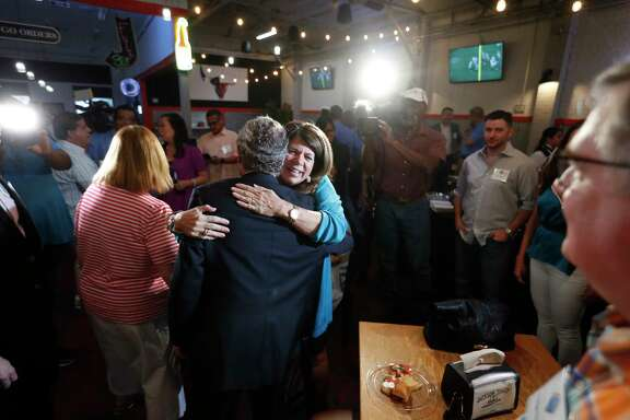 Harris County Judge Ed Emmett gets a hug from Kippy Caraway during the Proposition A-County Flood Bond election watch party at Jackson Street BBQ, Saturday, August 25, 2018 in Houston. Proposition A is a $2.5 billion bond proposal to help finance a 10 to 15 year program of flood mitigation projects.