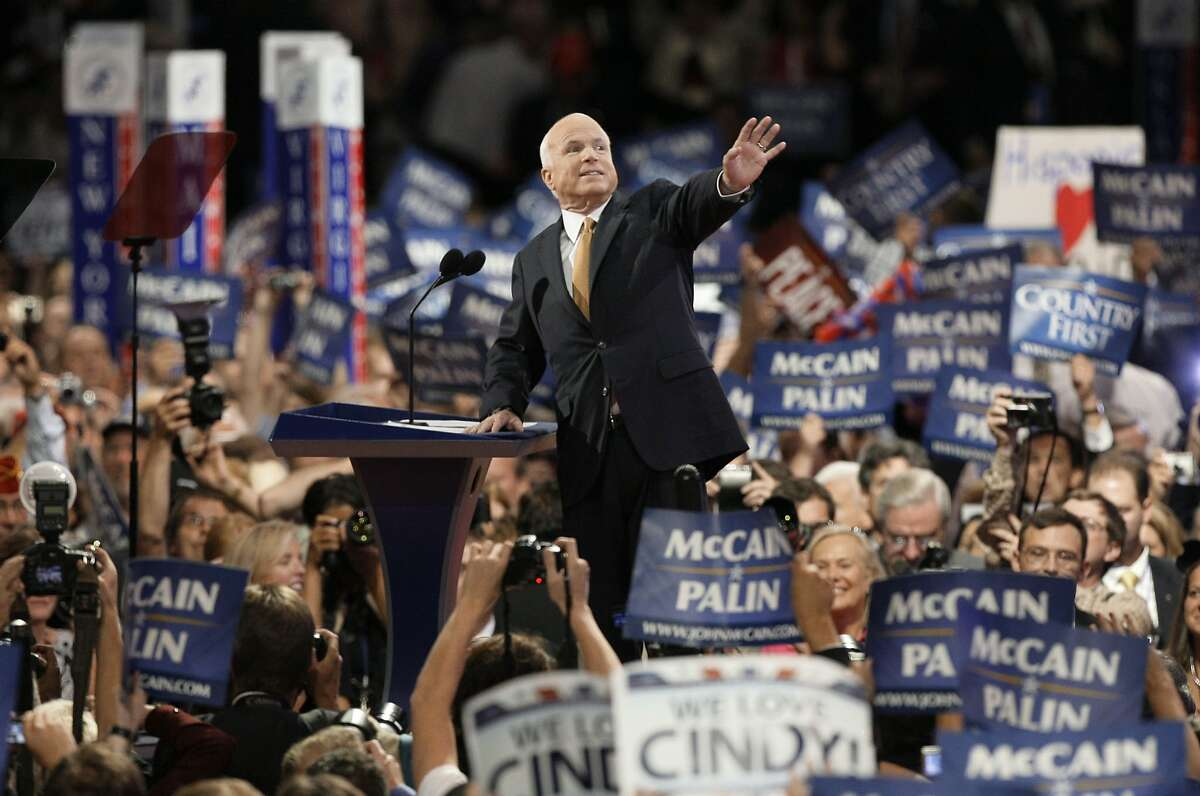 Republican presidential candidate John McCain acknowledges the crowed as he goes on stage at the Republican National Convention in St. Paul, Minn., Thursday, Sept. 4, 2008. (AP Photo/Charlie Neibergall)