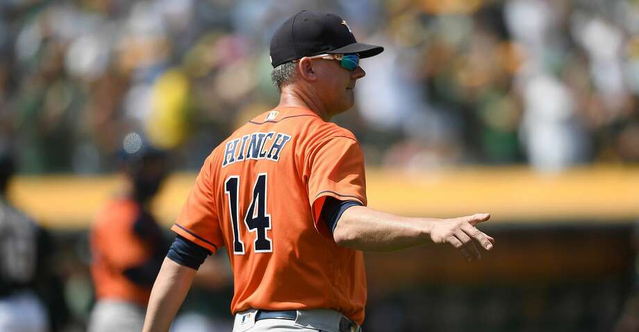 PHOTOS: Astros game-by-game OAKLAND, CA - AUGUST 18:  Manager AJ Hinch #14 of the Houston Astros signals the bullpen to make a pitching change against the Oakland Athletics in the bottom of the six inning at Oakland Alameda Coliseum on August 18, 2018 in Oakland, California.  (Photo by Thearon W. Henderson/Getty Images) Browse through the photos to see how the Astros have fared in each game this season. Photo: Thearon W. Henderson/Getty Images