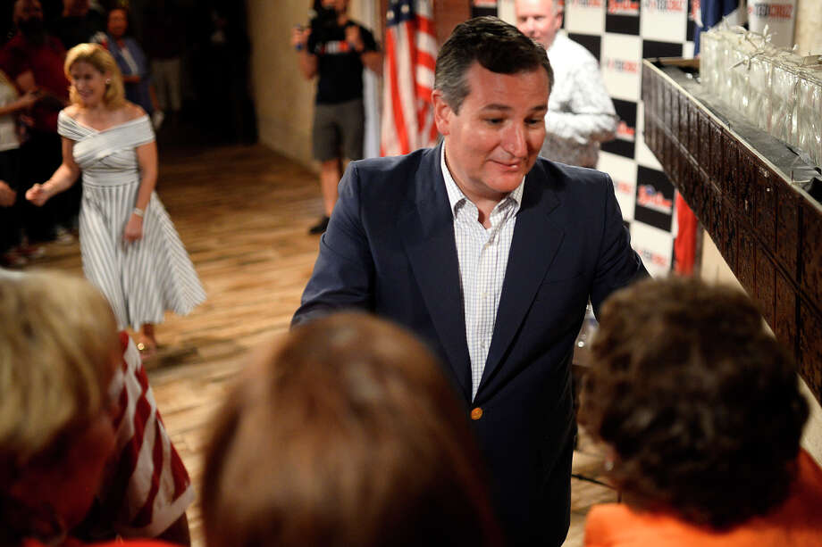 U.S. Sen. Ted Cruz shakes hands with attendees of a town hall event Aug. 25, 2018, at the South Forty Banquet Hall in Odessa, Texas. Pictured in background is Cruz's wife, Heidi. James Durbin/Reporter-Telegram Photo: James Durbin / © 2018 Midland Reporter-Telegram. All Rights Reserved.