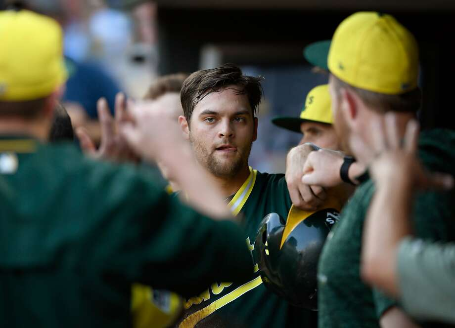 MINNEAPOLIS, MN - AUGUST 25: Chad Pinder #18 of the Oakland Athletics celebrates scoring a run against the Minnesota Twins during the second inning of the game on August 25, 2018 at Target Field in Minneapolis, Minnesota. All players across MLB will wear nicknames on their backs as well as colorful, non-traditional uniforms featuring alternate designs inspired by youth-league uniforms during Players Weekend. (Photo by Hannah Foslien/Getty Images) Photo: Hannah Foslien / Getty Images