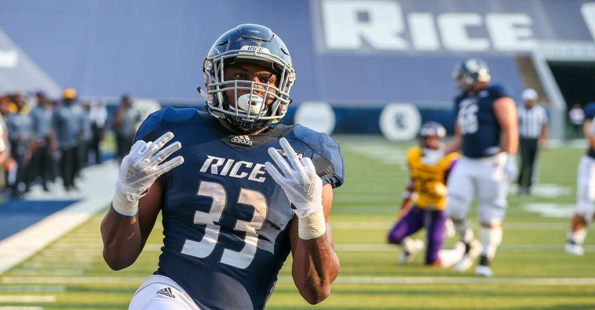 August 25, 2018: Rice Owls running back Emmanuel Esukpa (33) celebrates after scoring a touchdown in the first quarter of the college football game between the Prairie View A&M Panthers and Rice Owls at Rice Stadium in Houston, Texas. (Leslie Plaza Johnson/For the Chronicle)