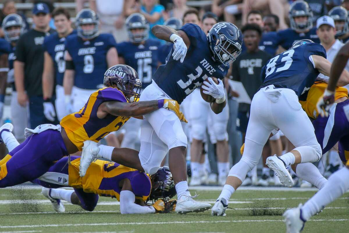 August 25, 2018: Rice Owls running back Emmanuel Esukpa (33) carries the ball during the college football game between the Prairie View A&M Panthers and Rice Owls at Rice Stadium in Houston, Texas. (Leslie Plaza Johnson/For the Chronicle)