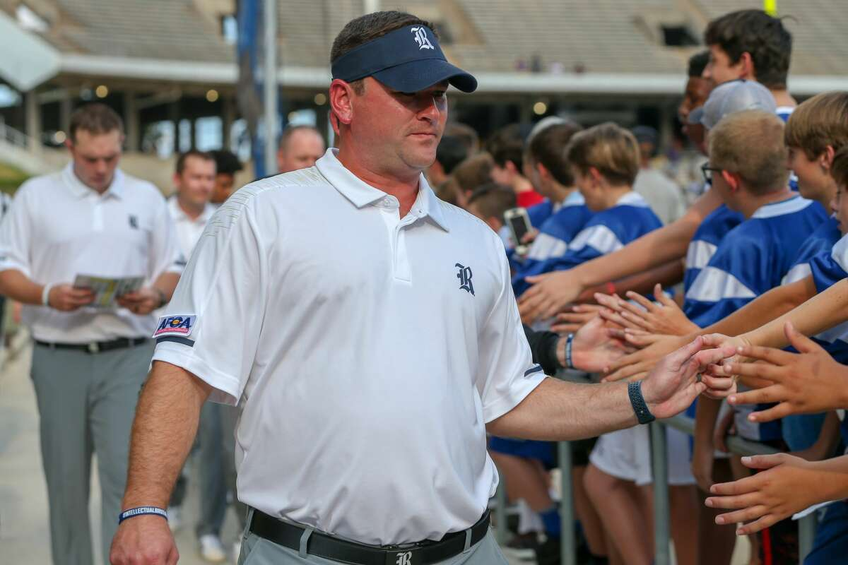 August 25, 2018: Rice Owls head coach Mike Bloomgren greets fans as he approaches the field during the college football game between the Prairie View A&M Panthers and Rice Owls at Rice Stadium in Houston, Texas. (Leslie Plaza Johnson/For the Chronicle)