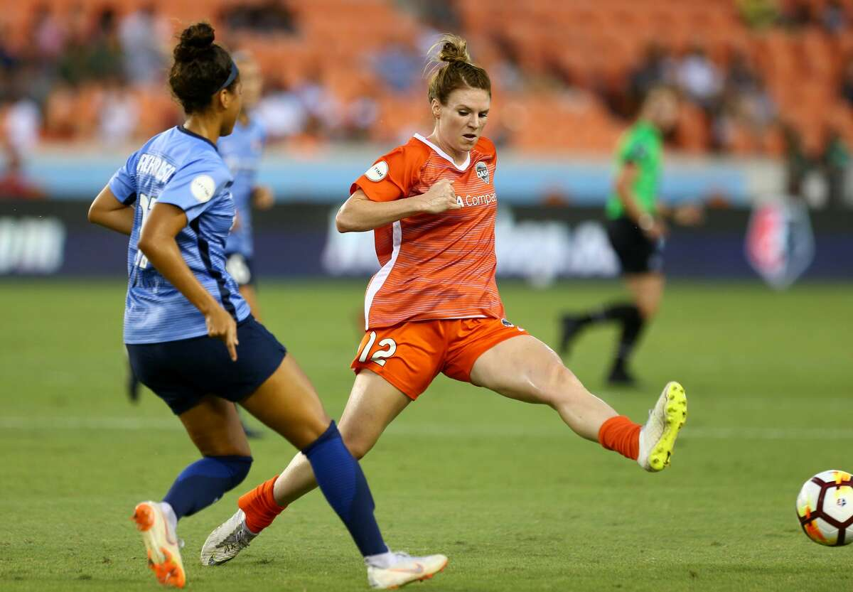 Houston Dash forward Veronica Latsko (12) tries to intercept the pass by Sky Blue FC defender Domi Richardson (17) during the first half of an NWSL match at BBVA Compass Stadium Saturday, Aug. 25, 2018, in Houston.