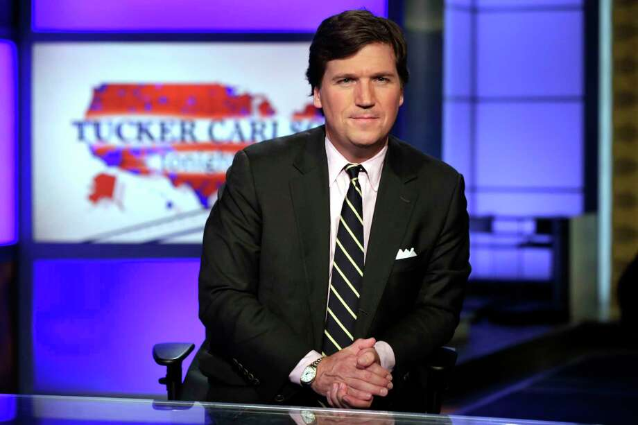 "FILE - In this March 2, 2017, file photo, Tucker Carlson, host of ""Tucker Carlson Tonight,"" poses for photos in a Fox News Channel studio in New York. Carlson says he's shocked his segments this week on a South African policy on land reform should be considered an appeal to white nationalists - let alone spark an international incident. (AP Photo/Richard Drew, File) Photo: Richard Drew / Copyright 2017 The Associated Press. All rights reserved."