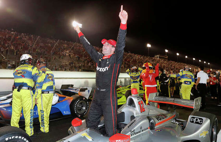 Will Power celebrates after winning the IndyCar auto race Saturday night at Gateway Motorsports Park in Madison. Photo: Jeff Roberson | AP Photo