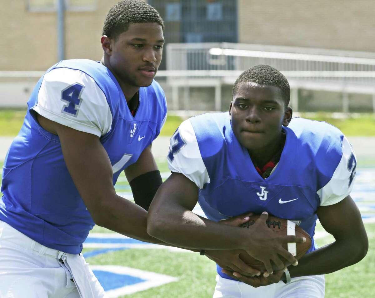 Jay quarterback Jacob Zeno (left), a Baylor commit, and running back Jaylin Hastings led Jay to a 7-4 record last season.