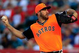 ANAHEIM, CA - AUGUST 25: Justin Verlander #35 of the Houston Astros pitches during the first inning of a game against the Los Angeles Angels of Anaheim at Angel Stadium on August 25, 2018 in Anaheim, California. All players across MLB will wear nicknames on their backs as well as colorful, non-traditional uniforms featuring alternate designs inspired by youth-league uniforms during Players Weekend. (Photo by Sean M. Haffey/Getty Images)