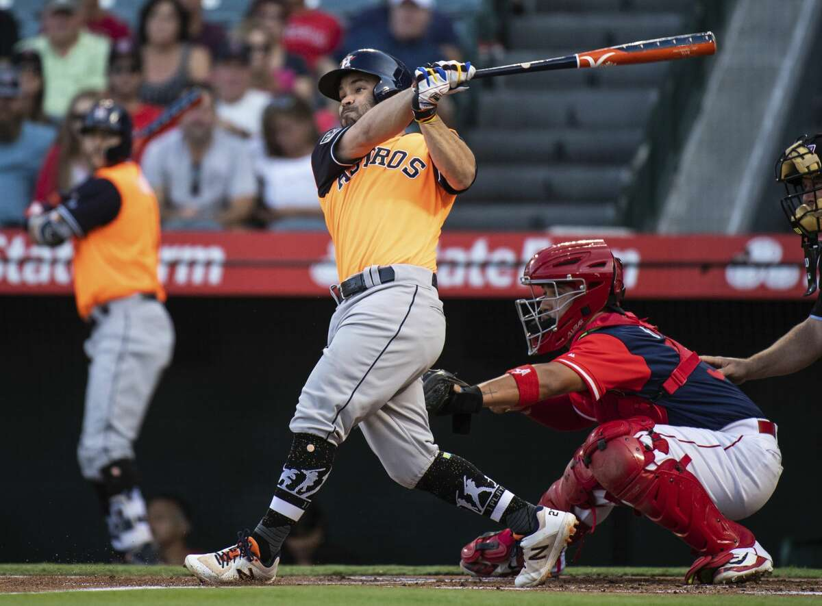 Houston Astros' Jose Altuve follows through on an RBI single during the first inning of a baseball game against the Los Angeles Angels in Anaheim, Calif., Saturday, Aug. 25, 2018. (AP Photo/Kyusung Gong)