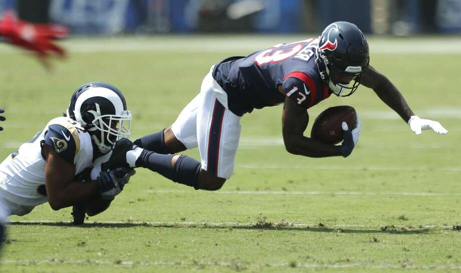 Houston Texans wide receiver Braxton Miller (13) is tripped up by Los Angeles Rams cornerback Troy Hill (32) during the first quarter of an NFL preseason football game at the Los Angeles Memorial Coliseum on Saturday, Aug. 25, 2018, in Los Angeles. Photo: Brett Coomer/Staff Photographer