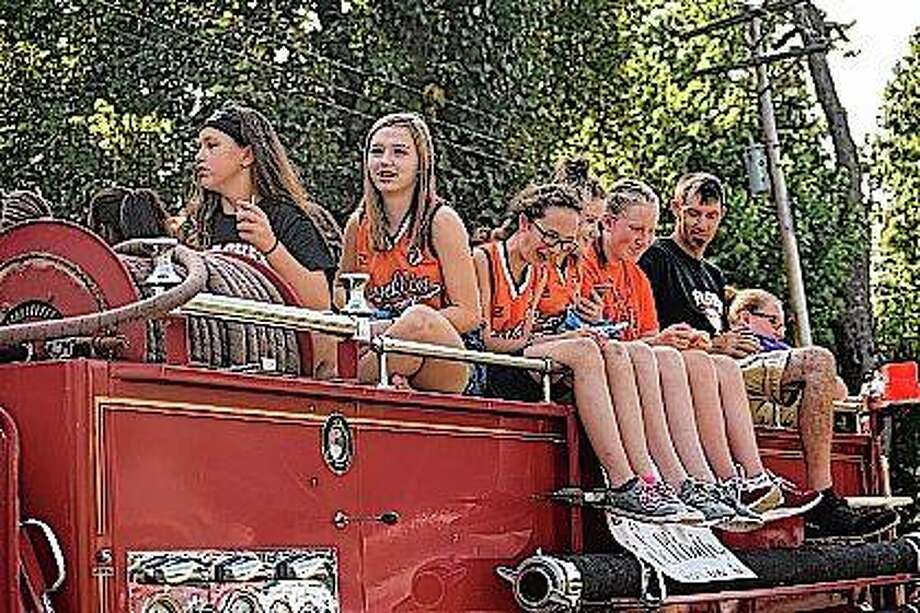 Members of the Franklin Jr./Sr. High Flashes softball team ride atop a fire truck at the Waverly Old-Fashioned Picnic on Friday.