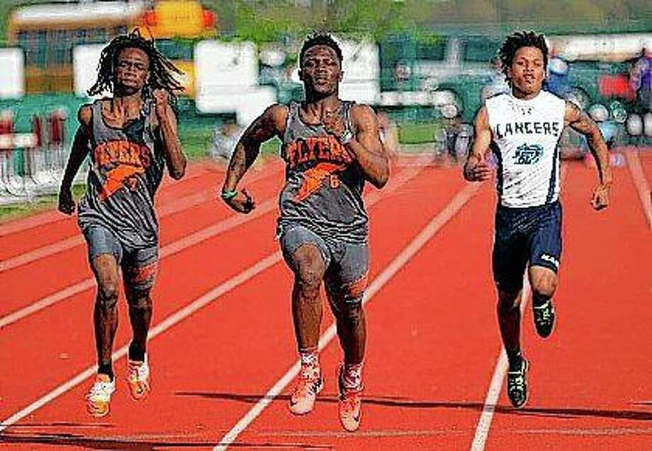 East St. Louis track and field athlete Willie Johnson (center) competes during a 400-meter event at the St. Clair County Boy's Track and Field Meet in St. Clair in 2017. Johnson remembers well the feeling of disappointment of not being able to compete at the IHSA boys state track and field meet earlier in the spring. Johnson is now a national champion. Photo: Zia Nizami | Belleville News-Democrat (AP)