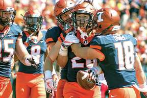 Illinois running back Mike Epstein (26) is congratulated by teammates after a touchdown run last season against Ball State at Memorial Stadium in Champaign.