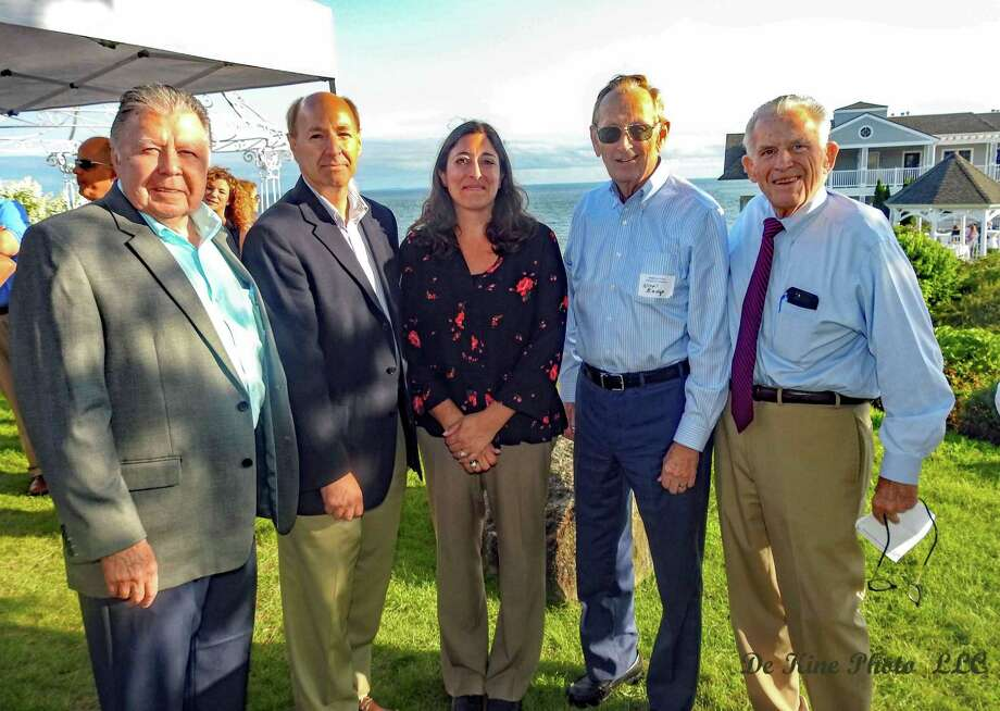 The Middlesex Chamber of Commerces Business After Work Networking Reception was hosted by Water's Edge Resort and Spa Aug. 21. From left are Middlesex County Chamber of Commerce Chairman Jay Polke, Waters' Edge Director of Sales Keith Lindelow, Vice President Tina Dattilo, Westbrook First Selectman Noel Bishop and Chamber President Larry McHugh. Photo: DeKine Photo LLC