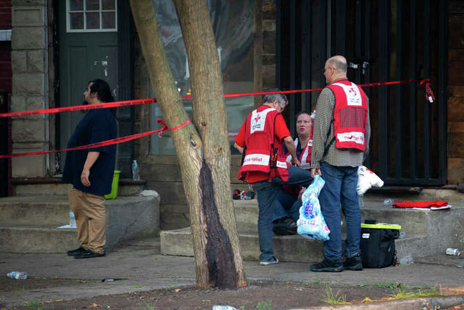American Red Cross workers remain at the scene after a fire killed several people including multiple children Sunday in Chicago. The cause of the blaze hasn't been determined. Erin Hooley | Chicago Tribune (AP)